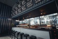 """In Berlin, on the site of """"Urbane Mitte"""" between eastern and western part of Gleisdreieck Park, a mobile brewery and beer garden designed by GRAFT has been. Bar Design Awards, Brew Pub, Brewery, Garden Design, Around The Worlds, Military, Table, Berlin Berlin, Furniture"""