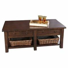 """Showcasing 4 drawers and 2 wicker baskets, this eye-catching coffee table is perfect for resting an afternoon espresso and stowing entertainment accessories.                                                 Product: Coffee tableConstruction Material: Wood and wickerColor: BrownFeatures:  Four drawersTwo baskets includedDimensions: 19"""" H x 50"""" W x 28"""" D"""