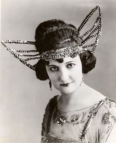 I think I would like this head piece for Date Night?  A real looker, don't ya think?  rosemary theby (1920s)