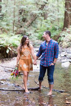 Engagement Portrait Holding Hands Walking in Creek Looking at Each Other Barefoot Holding Flowers | Half-Moon-Bay-Redwood-Engagement-Wedding-Photographer-TréCreative