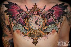 chest piece tattoo by Kid Kros..