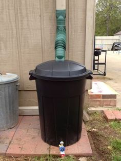 DIY Rain Barrel | 1 Crafty Lane. Except make sure to put a mesh screen in it to catch debris