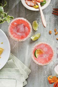 Pink Cadillac Margaritas - Spirited Cocktail Recipes - Southernliving. Fast Flourish: Rub rims of chilled glasses with a lime wedge, dip in a saucer of coarse salt and sparkling sugar, and twirl to coat.  Recipe: Pink Cadillac Margaritas