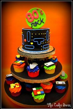 The 80's did rock--love the cupcakes with 80's memorabilia and the big cake being PacMan? Awesome.