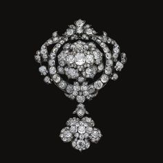 A diamond today glitters with blazing brilliance under bright electric lighting, outshining an older diamond cut in the century. The beauty of an old cut diamond is best appreciated by the war… Edwardian Jewelry, Antique Jewelry, Vintage Jewelry, Diamond Brooch, Diamond Pendant, Faberge Eier, International Jewelry, Diamond Are A Girls Best Friend, Diamond Cuts