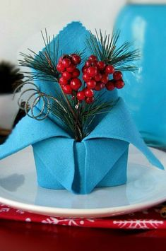 Holiday Crown Napkin Tutorial, Folded Holiday Crown Napkin Tutorial, Folded Holiday Crown Napkin Tutorial, Untitled Folded Holiday Crown Napkin Tutorial Crown Napkin Fold Napkin decorated with flower by Apolonia on How to Fold a Leaf Tutorial Christmas Dining Table, Christmas Table Settings, Christmas Table Decorations, Holiday Tables, Christmas Tree Napkin Fold, Christmas Napkins, Christmas Holiday, Christmas Trees, Holiday Ideas
