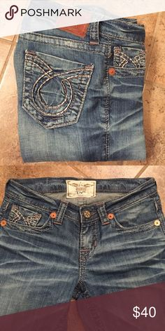 Big Star LIV Jeans 26x36 Medium color faded jeans. Navy and silver thick stitching. Fitted through the thigh. Big Star Jeans Boot Cut