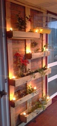 Pallet planters are not that difficult to build. Place vertical beams of pallet on the brick wall for support then fix four by one pallet cases or pallet planter on them. Use lights to decorate them and also hang cages to make the look complete Outdoor Projects, Home Projects, Craft Projects, Decoration Palette, Decoration Piece, Outdoor Lighting, Outdoor Decor, Lighting Ideas, Balcony Lighting