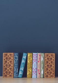 These handcrafted wooden bookends, engraved with a design by Coralie Bickford-Smith, are the perfect way to showcase the Penguin Clothbound series of Jane Austen novels.