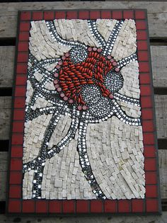 Red part looks 3D. Looks like a spider. Cool mosaic idea