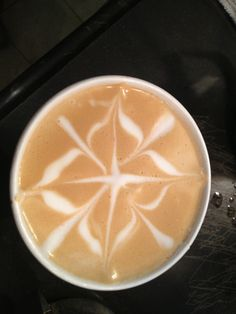 Latte art by Taylor from our Mequon cafe! #latte #coffee #fiddleheads