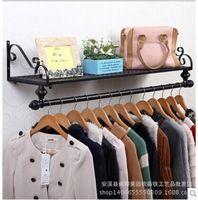 Bastidores pantalla ropa de hierro en la pared lateral del colgante tienda de ropa ropa estante de exhibición de piso