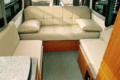 """Quicklinks 1 EB Gauchos/Beds 2 EB Mid-Dinettes 4 EB Couches 5 Dinettes W 6 RB Gauchos 7 Bunk/Platform 8 Captain Seats Page 4 DYO EB Example – Forward-Facing Couch with Ottomans """"My wife and I planned on owning a Sportsmobile for years. As you can see, we finally made the commitment."""" —the Wilkersons Couch with Ottomans makes into a veryContinue Reading"""