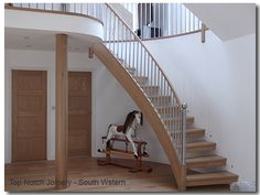 Curved oak, open tread staircase with stainless steel balustrade