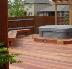 This Archadeck hot tub deck has adequate and convenient bench seating built into the deck's design