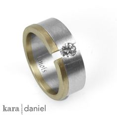 vintage diamond ~ tension-set in stainless steel wedding ring with recycled gold. by kara | daniel, via Flickr