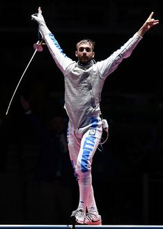 Italy's Daniele Garozzo celebrates winning against US Alexander Massialas after the mens individual foil gold medal bout as part of the…