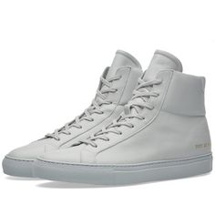 The Achilles is the definitive, original Common Projects design, appearing in multiple guises throughout the brand's seasonal collections. This edition goes back to its original incarnation, crafted in Italy from the finest calf leather, the high top sits atop a rubber cupsole and has been styled with a full leather lining, padded ankle and flat woven laces.  Calf Leather Uppers Padded Ankles Leather Lined Rubber Cupsole Gold Stamped Style Code To Heel Made In Italy