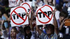 Are You Ready to Defeat the TPP this November? Join the #NoLameDuckUprising    ---    Delegates protesting against trade agreement hold up signs during the first sesssion of the Democratic National Convention in Philadelphia