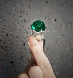 A 40 carats Colombian Cabochon Emerald Ring with no enhancement by FORMS.