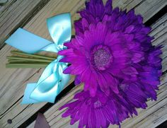 $18 in Stock, great bouquet, 9 realistic silk purple gerbera daisies tied with your choice of ribbon, seen here tied with aqua satin ribbon.