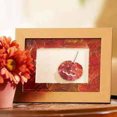 Gather pressed and varnished leaves and plain picture frame. Lay your mat on a work surface and brush decoupage medium all around it. One at a time, press leaves into the mat, folding them over the edges. Cut any excess with a craft knife.