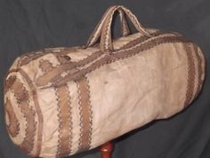LINEN DUFFLE BAG W FEATHER STITCHING.  Measures 21 inches in its length and when stuffed full measures 31 inches around.