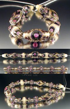 One of my newest designs for me, incorporating matching petite beads with my chunky barrel set. Colors in the Vienna group are ivory, purple, greenstone, fushsia, goldstone and metallic glass.   25__beads measuring 13 inches in length.   Barrels: 1__Coronation focal: 34 mm by 17 mm. 4__Barrel beads: 23 mm by 14 mm. 2__Cone beads: 18 mm by 12 mm.   Hobnail & Petites (6):  6__Hobnail petites: 9 mm by 13 mm. 12__Metallic rib