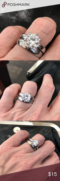 Show Stopper Ring This ring would be perfect to wear on vacation when you don't want to worry about your real deal. It's a 6 prong size 5 silver tone QZ engagement ring. Looks like the real thing which makes wearing this so much fun!! Jewelry Rings
