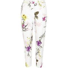 River Island Cream floral print cigarette pants (£64) ❤ liked on Polyvore featuring pants, trousers, white trousers, floral pants, cream trousers, cigarette pants and cigarette trousers