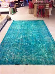 turquoise vloerkleed woonkamer