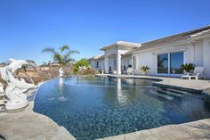 Cool off in this crystal blue swimming pool with expansive views of the California hillside.