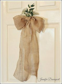 Rehearsal Dinner Decorations - Affordable and stunning wedding decorations! Tie burlap into a bow, then place real baby's breath and greenery at the top!