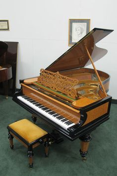 """In person, this Bechstein 6'8"""" Grand Piano Ebony and Burl Cherry - Art Case glitters like gold...very art neuvo...something Liberace would play"""