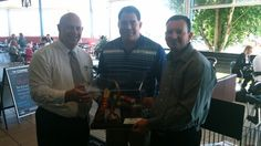 Bill Richards, Mal Meninga and Peter Greenham with Eagle Dreaming footy boots at the Springwood Coffee Club September 10 2014