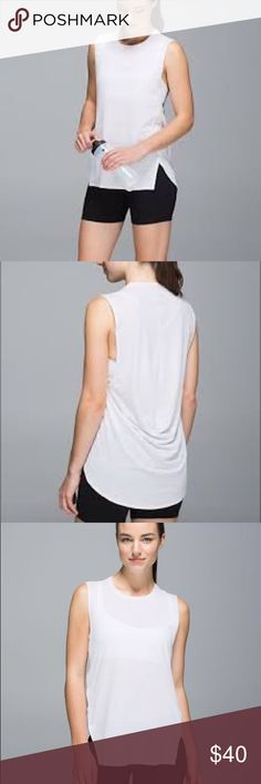Lululemon Yogi Muscle Tee Lululemon Yogi Muscle Tee in heathered white. High crew neck, loose fit with oversized arm holes. Hip length - slightly longer back. Sweat-wicking, light weight Luon fabric with Silverescent technology that inhibits odor causing bacteria. Rip tag has been removed but believed to a size 4 (see measurements). Excellent condition. Lululemon Tops Muscle Tees