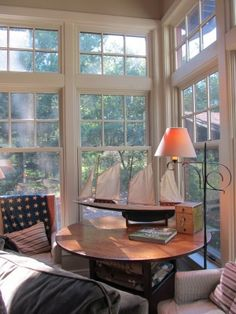 002 sun porch with model ship on table iron lamp