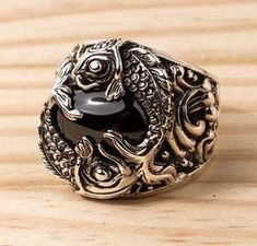 If you are looking for both spellbinding and meaningful accessory, our Onyx Sterling Silver Koi Gothic Ring is right up your street. It's made of solid silver Gothic Rings, Gothic Jewelry, Gold Rings Jewelry, Silver Bracelets, Diamond Jewelry, Men's Jewelry, Jewelry Center, Jewelry Stores, Silver Jewellery