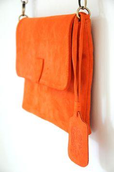 Bright orange suede bag