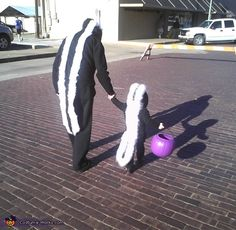 DIY Baby Skunk and Mommy Skunk Costumes by costume-works: So easy. Black jacket, black pants, white under shirt, and black material for the tail and white fur for the strips! #DIY #Halloween #Costume #Skunk