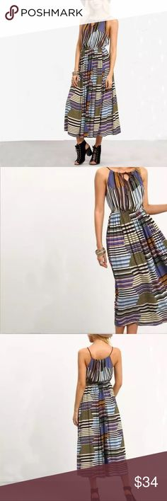 """New! BOHO maxi patchwork PRINT keyhole M stripe New! Lovely patchwork print colorful maxi dress. Medley of colors in a striped mix including olive, orange, navy and sky blues, purple. Elastic waist, brown braided spaghetti straps that tie at the neck to create a keyhole. So Medium. About 54"""" long, waist goes from 12"""" to 15"""" across. Bust about 17"""" across. Rayon.  (701) Dresses Maxi"""