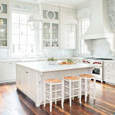 Square Kitchen Island with Backless Rush Street Counter Stools and White Carriage Lanterns - Cottage - Kitchen All White Kitchen, New Kitchen, Kitchen Decor, Kitchen Ideas, Decorating Kitchen, French Kitchen, Decorating Ideas, Elegant Kitchens, Beautiful Kitchens