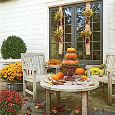 Spice Up the Patio with a Harvest of Decorations | Bring the season to the table with a decorating recipe that calls for pumpkins and mums in warm shades of paprika, cinnamon, and curry. Add a helping of Indian corn on the side, and don't forget to sprinkle in assorted pecans, hickory nuts, and a few acorns gathered from your yard.