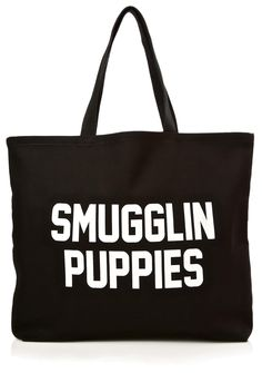 "Smugglin' Puppies Tote cuz you just can't keep it on the down-low, can ya bb? Free some Frenchies with this sikk tote featuring a sturdy cotton construction and bold white print that reads ""SMUGGLIN PUPPIES""."