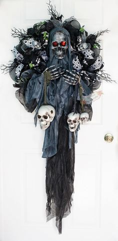 This creepy skeleton Grim Reaper themed wreath is perfect for setting the mood this Halloween. It is an XXL wreath and the Grim Reaper eyes