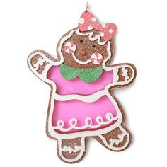 """$15.50 Tutti Frutti Gingerbread Girl Ornament - Her cookie body is filled with hard candy in pink cherry that glimmers when back lit with your Christmas lights.  Her body has been piped with white royal icing and her cheeks are made from peppermint candy.  This delightful gingerbread girl is trimmed with a pink and white polka dot bow in her hair and an spearmint green peter pan collar.  This delightful ornament is finished with a  red and white satin ribbon for hanging. 8"""" Tall Made of…"""