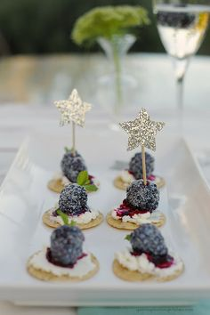 Blackberry goat cheese crackers with dusted sugar and star toothpicks