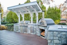 It's time to fire up your excitement for the stunning outdoor kitchen plans. A captivating deck and the covered pergola over the kitchen both are leading this delicious cooking project to the limits of perfection. There is the large margin in this setup, so you can also locate your dining and relaxing furniture near the plan.