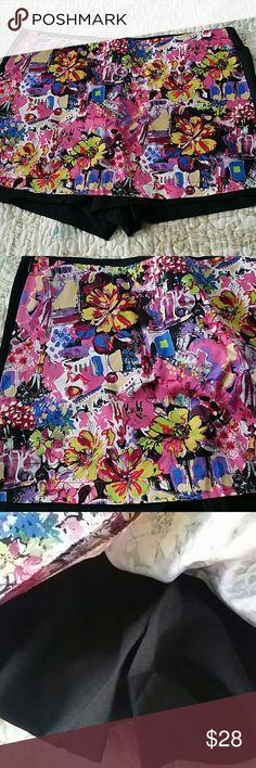 "Floral skort Black short with fun mixed pattern skirt at the front. Hidden zipper. Large waist laying flat 15.5"", length, side length 12"". Medium waist flat is 14.5"", side length 12"" Shorts Skorts"