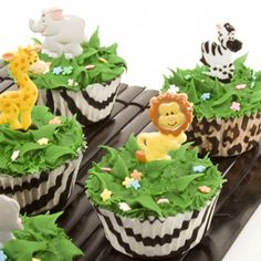 what about something like this . . . with the giraffe cupcake holders the decorateive looking grass and then just little plastic stick ins of the movie characters?